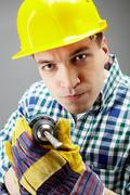 portrait of architect working with electric drill - stock photo