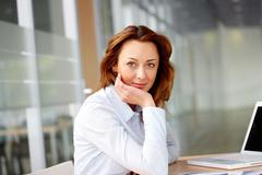 Stock Photo of portrait of smiling businesswoman at workplace