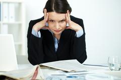 portrait of stressed office worker in trouble - stock photo