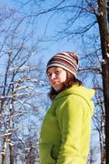 a teenage girl in the park in the winter - stock photo