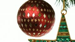 Beaded ornaments hanging from a christmas tree branch Stock Footage