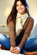 portrait of young teenage girl looking at camera and smiling - stock photo