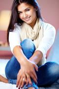 portrait of young girl posing at camera at home - stock photo