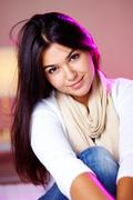 portrait of pretty brunette girl looking at camera and smiling - stock photo