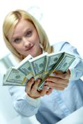 woman reaching out dollar rolls - stock photo