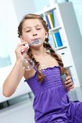 Portrait of cute girl blowing soap bubbles Stock Photos