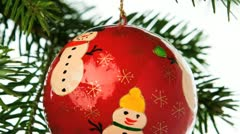 Hand painted ornament hanging from a christmas tree branch Stock Footage