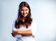 Stock Photo of image of young woman in casual clothes smiling at camera