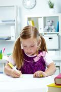portrait of lovely girl drawing with yellow highlighter - stock photo