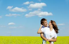 Image of happy couple in yellow meadow at summer Stock Photos