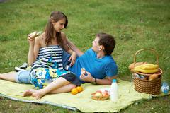 portrait of man and his girlfriend on picnic - stock photo