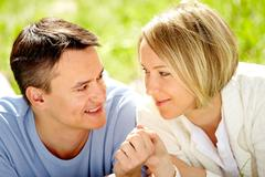 Portrait of amorous couple looking at each other with smiles Stock Photos