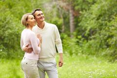 portrait of young happy couple enjoying wonders of nature - stock photo