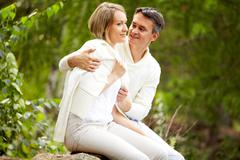 Portrait of amorous couple spending time in park at summer Stock Photos