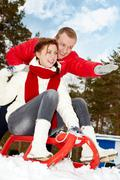 Portrait of happy couple in warm clothes on winter vacation Stock Photos