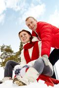 Portrait of happy couple having nice time during winter vacation Stock Photos