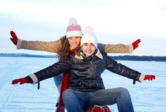 Portrait of happy couple in warm clothes having nice time in winter Stock Photos