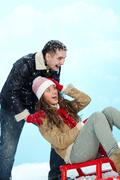 portrait of happy couple in warm clothes having fun in winter - stock photo