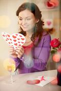 A young girl in restaurant holding valentine card Stock Photos