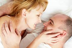 Close-up of wife and husband looking at each other with love Stock Photos