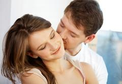 pretty woman has pleasure from male kisses - stock photo