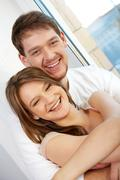 portrait of joyful handsome man hugging his girlfriend - stock photo