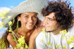 portrait of happy couple spending time outside - stock photo