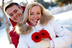 photo of happy man and woman outdoor in winter - stock photo