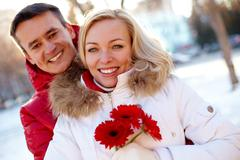 Photo of happy man and woman outdoor in winter Stock Photos