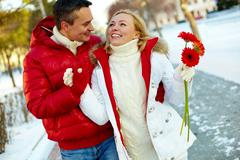 photo of amorous couple walking outdoor in winter - stock photo