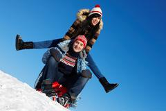 portrait of happy couple in warm clothes spending time outdoor in winter - stock photo