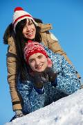 Portrait of happy couple in warm clothes having good time in winter Stock Photos