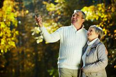 Photo of senior couple in the park in autumn Stock Photos