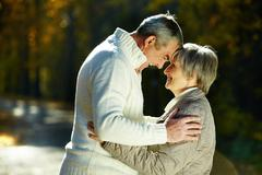 Photo of amorous aged man and woman in the park Stock Photos