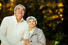 photo of senior husband and wife spending free time in park - stock photo