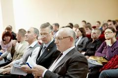 chelyabinsk – april 14: mature man consulting document at conference, april 14, - stock photo