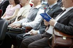 row of audience listening to the speaker at conference - stock photo