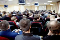 audience listening to the speaker at conference in hall - stock photo