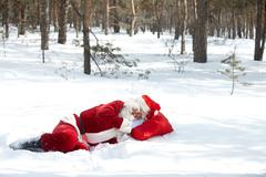 Santa claus sleeping in winter wood Stock Photos