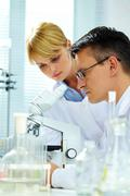 Two clinicians making experiments in laboratory Stock Photos