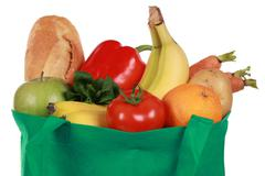 Reusable shopping bag filled with groceries Stock Photos