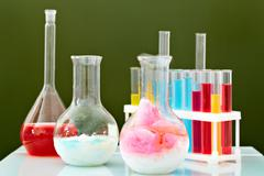 Image of glass bottles and flasks in laboratory Stock Photos