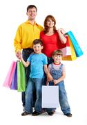 Photo of friendly parents and siblings with bags isolated over white background Stock Photos