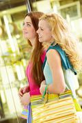 two young beautiful women shopping together - stock photo