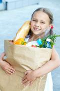 Portrait of a little girl with foodstuff Stock Photos