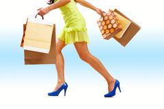 Legs of lady with colorful paper bags in move Stock Photos