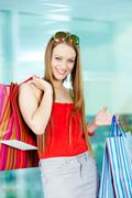 portrait of happy girl with paperbags after shopping - stock photo