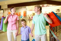Portrait of husband and wife with their son after shopping Stock Photos
