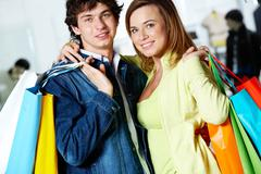 Portrait of loving couple after buying gifts looking at camera with smiles Stock Photos