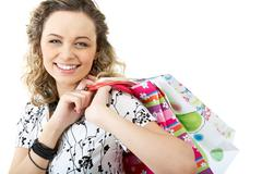 happy female with bags looking at camera with smile - stock photo